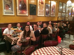 Bellevue DECA dining on pizza before the Collegiate DECA 2015 ICDC: Dillon, Keith, Madison, Kyle, Daniel, Dan, Andy, Dorel, Olivia, Conner, Susan, Gabe, Vincy, Charlize