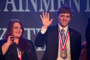 Andy Norris of Bellevue DECA receives his award for Finalist in Sales Management, presented at the Collegiate DECA 2015 ICDC