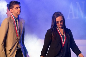Keith Monaghan and Olivia Wright of Bellevue DECA receive their awardd for Finalists in Financial Statement Analysis, presented at the Collegiate DECA 2015 ICDC