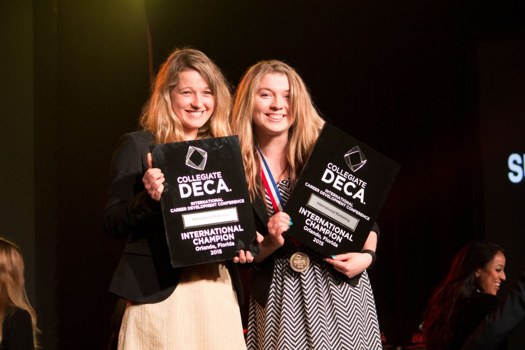 Tana Rulkova and Susan Petris of Bellevue DECA receive their 2015 National Championship awards in International Marketing, presented at the Collegiate DECA ICDC in Orlando, Florida.